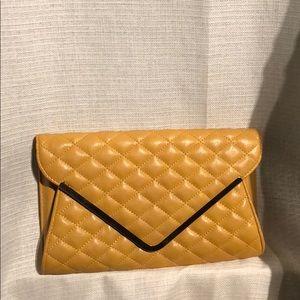 Handbags - Mustard yellow vegan leather clutch